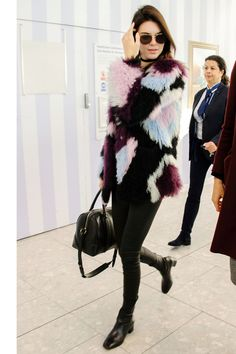 Kendall Jenner masters airport style in a colorful fur coat and leather boots. Click through to see all the model's best street style looks  - HarpersBAZAAR.com