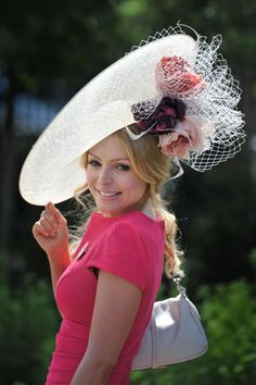 royal hats...How clever. On a Red hat, pin roses underneath with the netting! Love it.