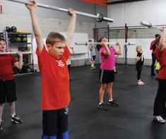 A Professional Strength Coach On When It's Safe For Your Kid To Lift Weights
