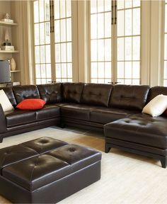 Sectional couch...  I like the brown leather.  We could change colors just by changing pillows and accents.  I think I would choose upholstered accents and ottoman to break up the brown though.