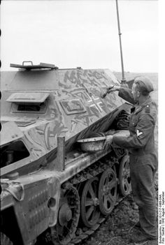 USSR-South - preparing to attack Stalingrad, soldier paints camouflage on a light armored vehicle (Sd.Kfz 253rd) during a break in the advance. The pattern is of individual decision.