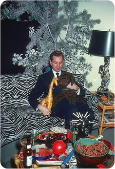 The zebra lamp, the sofa, the insane cigarette holder, the stuffed animals.  I want to be there!