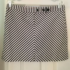 J. Crew striped skirt Navy blue and white striped skirt. Button and zip closure, with three buttons across the waist. Pockets on the front. Worn less than a handful of times. Smoke and pet free home. No trades, offers considered through offer button. J. Crew Skirts Mini