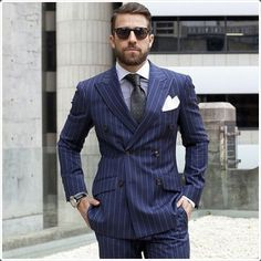Explore the gentleman in yourself. Wear a stripped pattern double breasted suit. It depicts the professionalism in you.