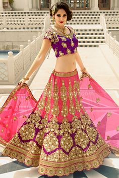 Gorgeous Art Silk fabric Hot Pink and Purple coloured Lehenga is beautifully crafted with resham, zari, stone, pita, sequins, diamond work and designer cut work border. Comes along with this Art Silk fabric Purple coloured Choli and Net fabric Hot Pink coloured designer Dupatta.