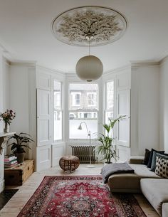 In the white-painted sitting room, a marble fireplace is enlivened with parquet tiling, and wooden floorboards with a Persian rug. We carry similar rugs in our collection. Living Room Carpet, Rugs In Living Room, Interior Design Living Room, Home And Living, Living Room Furniture, Living Room Designs, Home Furniture, Furniture Quotes, London Living Room