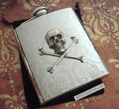 Silver Skull Flask Gothic Victorian Steampunk Accessories Large Size 8 oz Skull & Crossbones. $75.00, via Etsy.