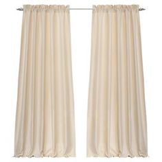 """Refresh your windows with this handcrafted curtain, finished in timeless ivory and highlighted by gathered headers.    Product: Set of 2 curtain panelsConstruction Material: Brushed polyesterColor: IvoryFeatures: Handcrafted2"""" HeaderDimensions: 84"""" H x 42"""" W eachCleaning and Care: Machine washable"""