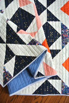 Scandinavian design with a twist. This Nordic Triangles Quilt Pattern is a Suzy Quilts best seller for a reason.
