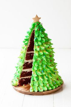 It's not too late to make this super festive Red Velvet Christmas Tree Cake for the holidays! A little bit of carving, a simple star piping tip, and a handful of magic brings this tree cake to life in no time. Christmas Tree Cake, Christmas Cake Decorations, Christmas Sweets, Christmas Cooking, Holiday Cakes, Christmas Birthday Cake, Holiday Desserts, Christmas Cupcakes, Christmas Bake Off