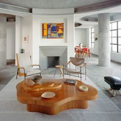 A very sexy fireplace complimented with a well thought collection of furniture and art.