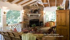 Exposed white rafters along with stone fireplace create a cozy screened porch. From The Porch Company via Front-Porch-Ideas-and-More.com #porch