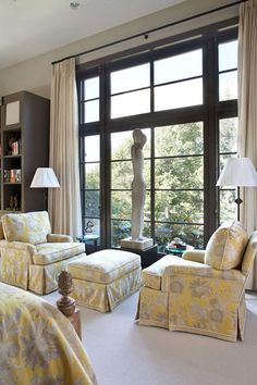 Beautiful area in the masterbedroom!  Love the windows and the scuplture!