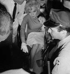 Marilyn leaving Manhattan Polyclinic Hospital after gall bladder surgery, July 11th 1961.