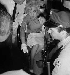 Marilyn leaving Manhattan Polyclinic Hospital after gall bladder surgery, July 11th 1961.