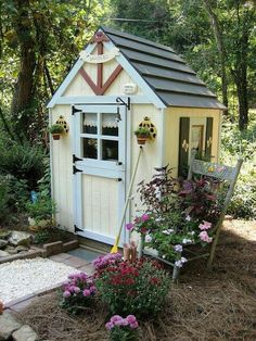 Cute garden shed (or playhouse!)   Look Cassie, a plant chair! :-)