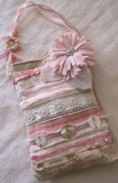 Glorious... A perfect use for all those bits and scraps of pretty things in my sewing basket.
