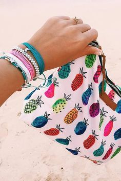 Our Pineapple Clutch + Stack of Pura Vida Bracelets Use the code BRIDGETKARCHER20 to get 20% off