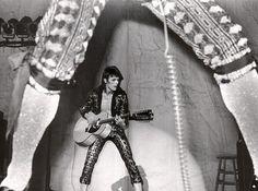 through Mick Ronson's legs