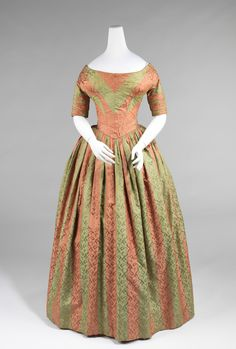 The female silhouette of the middle of the 19th century consisted of a fitted corseted bodice and wide full skirts.  The conical skirts developed between the 1830s, when the high waist of the Empire silhouette was lowered and the skirts became more bell s