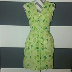 """""""Hearts of Love"""" dress NWT Brand new with tags  Playful """"Hearts of Love"""" Dress. Adorable 2 toned green hearts cover this dress! Ruffle and button details add even more cuteness to this dress! Opening on the skirt pic #4. Pair with heels and floppy hat.  Zips up on side White lining   Price is firm No trades Dresses"""