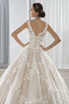 V-back ball gown with shimmering lace appliques and sheer straps. #DemetriosBride Style 640.