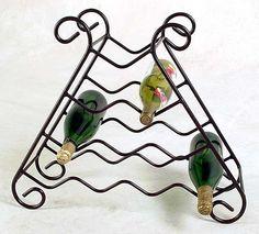 Wrought iron wine rack. http://www.gawroughtiron.com