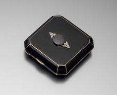 An art deco garnet, diamond, enamel, silver gilt powder compact by Marzo.c 1925