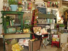 Add height and color up high to draw the eye in. Much more interesting this way!!! Great antique mall booth look!