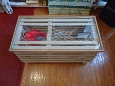 Lobster Trap Coffee Table...Paint it white, use netting, shells, lights, small piece of driftwood as deco for the inside
