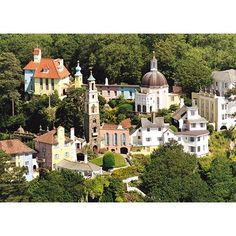 'a little bit of Italy in Wales' (aerial view of village)  Portmeirion is a popular tourist village in Gwynedd, North Wales. It was designed and built by Sir Clough Williams-Ellis between 1925 and 1975 in the style of an Italian village and is now owned by a charitable trust.