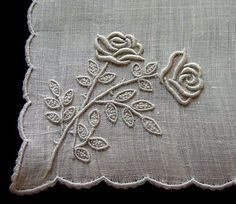 Handcrafting a satin stitch flower embroidery may well be a lost art in the near future. However, this is a skill that anyone can practice and learn and make beautiful embroidery handpieces for all occasions. Creative Embroidery, Hand Embroidery Designs, Vintage Embroidery, Custom Embroidery, Ribbon Embroidery, Embroidery Patterns, Embroidery Stitches, White Embroidery, Lace Beadwork