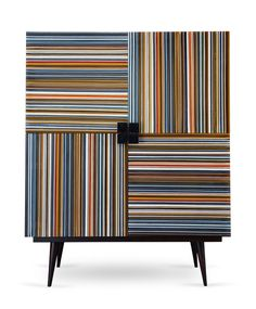 LORETTA'S INTERIOR DESIGN CABINET | This unique furniture piece plays with colors in a rare form | See more at: www.bocadolobo.com #moderncabinets #luxurycabinets