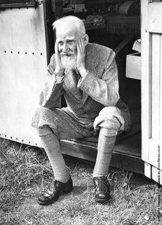 Irish playwright George Bernard Shaw (1856–1950) sits in the doorway of the garden shed at his home in Ayot St. Lawrence, Hertfordshire, where he does most of his writing, July 1946. (Photo by Central Press/Hulton Archive/Getty Images)