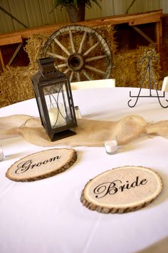 Country Wedding Table Decor. If you like the bride and and groom wood pieces I could get my brother to do it. He has a wood burning set