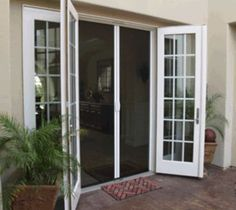Retractable screen doors are screen doors covered by roll-up blinds that open either vertically or horizontally. The retractable screen doors are very convenient to use. French Doors With Screens, Double French Doors, French Doors Patio, Patio Doors, Windows And Doors, Entry Doors, French Doors Bedroom, Patio Door Screen, Double Screen Doors