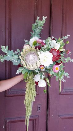 Beautiful native bouquet, with white King Protea, proteas, paper daisies and amaranthus