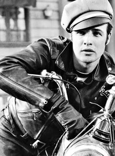 "Marlon Brando as Johnny in the Iconic motorcycle film ""The Wild One"" which simultaneously thrust biking forward into the limelight in terms of popularity and style, while setting it back in terms of stereotypes and the court of public opinion. Marlon Brando rode his own 1950 Thunderbird in the film– a big boost for Triumph motorcycles."