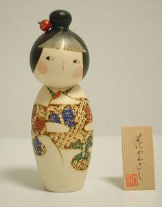 Kanzasi by Tatsuo Kato. A proud design showing an ornemental flower hairpin