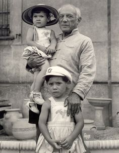 image 7. Picasso with Paloma (b. 1949) in arms, Claude (b. 1947), photo 1951