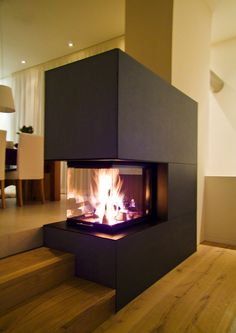 "Dass der im allgemeinen als kühl wahrgenommene Baustoff Beton nicht im Widerspr… The fact that the generally perceived as cool concrete building material does not have to contradict the warm living object ""tiled stove"" prove … House Design, Interior, Home Fireplace, Home Furniture, Fireplace Design, House Styles, House Interior, Home And Living, Home Decor Furniture"