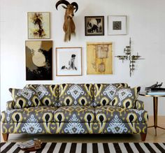 there's a lot going on here that i like: gallery style art hanging, ikat, color...