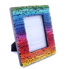 Rainbow frame made from rolled pieces of magazine pages.