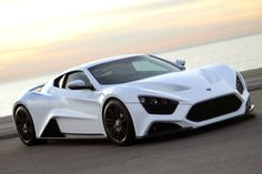 "Zenvo ST1:  233 mph, 0-60 in 2.9 secs. Twin-Charged 7.0 liter V8 Engine forging 1,104 hp. Base price: $1,225,000. The first Supercar from Zenvo Automotive, a Danish sports car company in pursuit of speed and perfection. This 100% Danish made supercar is limited to 15 units and the company even promised ""flying doctors"" to keep your baby functioning."