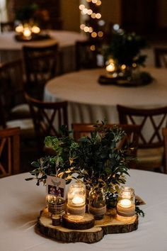 Intimate Greenery Wedding at Packington Moore Rustic Wedding Venue with 'Milan' St Patrick Bridal Gown Rustic Table Wedding Decor with Foliage & White Floral Centrepieces Green Wedding Centerpieces, White Floral Centerpieces, Centerpiece Ideas, Rustic Table Centerpieces, Rustic Candles, Rustic Wedding Table Decorations, Rustic Theme Party, Lantern Centerpieces, Diy Wedding Table Decorations