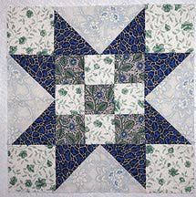 Evening star is a favorite quilt block pattern, and this lovely version of the star has a nine-patch block at its center.