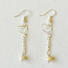 Made a pair of silver wire tiny heart dangling chain earrings with freshwater pearls!