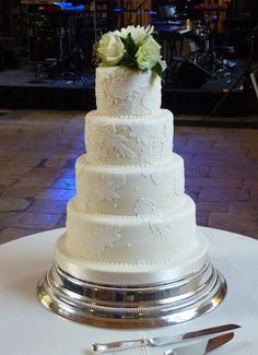 Tiered Wedding Cake - lace and real flower topper from Cake by Rachel