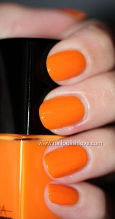 Orange fingernail polish-this has been one of my go to colors this summer!