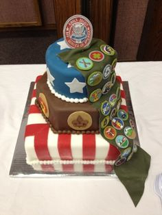 My favorite Eagle Scout cake! The merit badges are all cut by hand, and the 2nd tier is a hexagon with the 6 other rank badges on it.